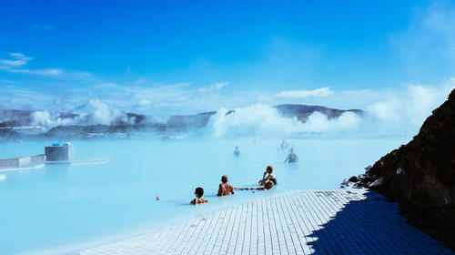 People relaxing at a geothermal spa in Iceland